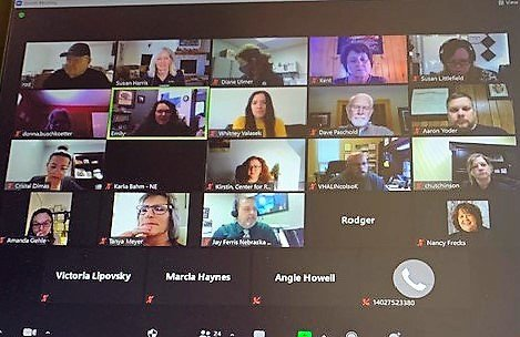 Screen shot of a Zoom meeting of the Board showing 20 small pictures of the participants.