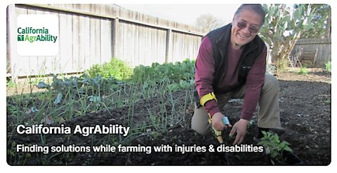 Picture of a man kneeling in a garden facing the camera and using an adaptive garden tool with a sign against a wood fence running along the left side of the photo that reads California AgrAbility