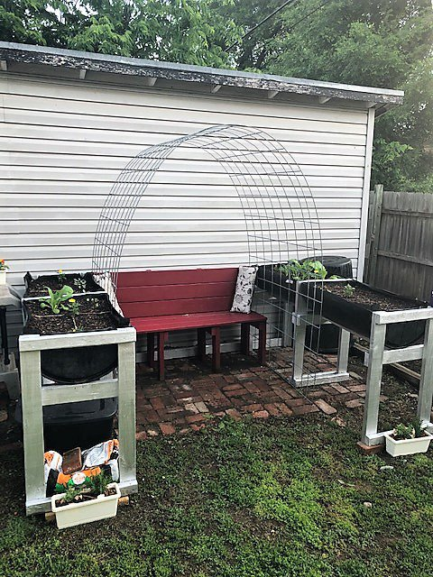 2 raised-bed planters with a bench seat in between them