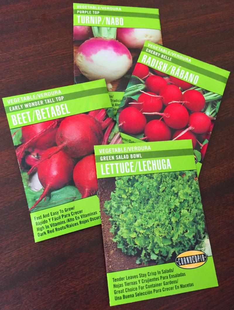 Seed packets of cool season crops including turnips radishes beets and lettuce