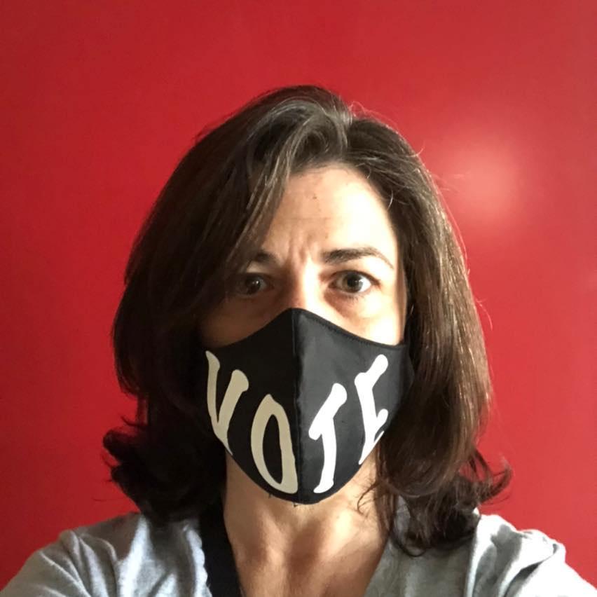 Julie Christensen wearing a black mask that says
