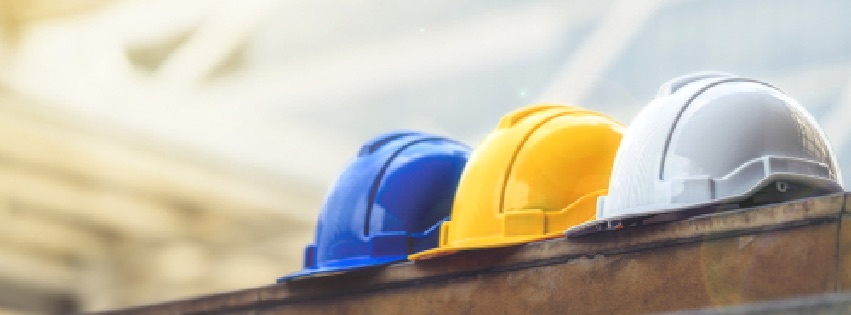 white_ yellow and blue hard safety helmet hat for safety project of workman as engineer or worker_ on concrete floor on city.