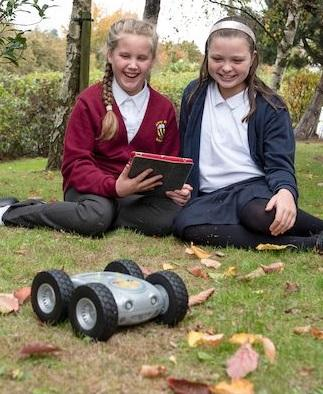 Tuff-Bot outdoors with students
