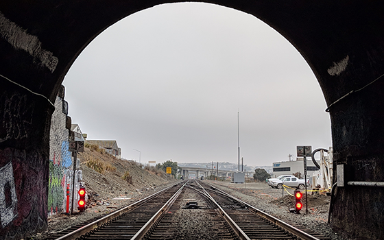 a shot showing the view from the inside out of an SF Caltran tunnel.