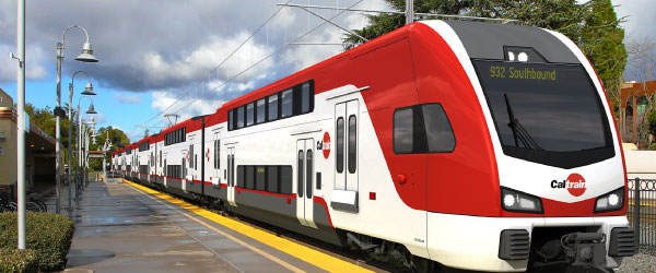 Electric caltrain stopped at a station