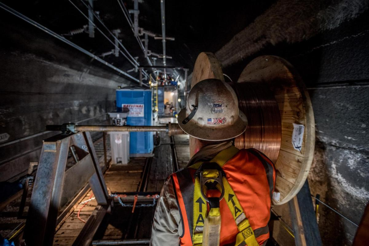 Construction workers working on Caltrain tunnel shutdown.