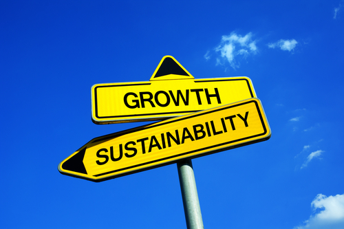 Growth or Sustainability - Traffic sign with two options - deciding between economical and financial progress and responsibility to nature and environment. Prosperity and development vs future