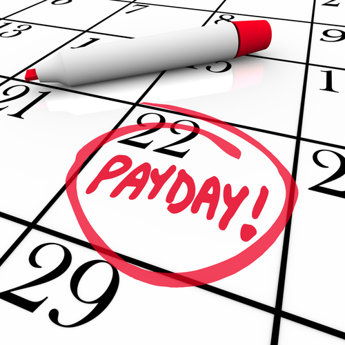 The word Payday circled in red marker on a calendar to remind you of the date you receive your wages_ income and earnings so you may budget your finances