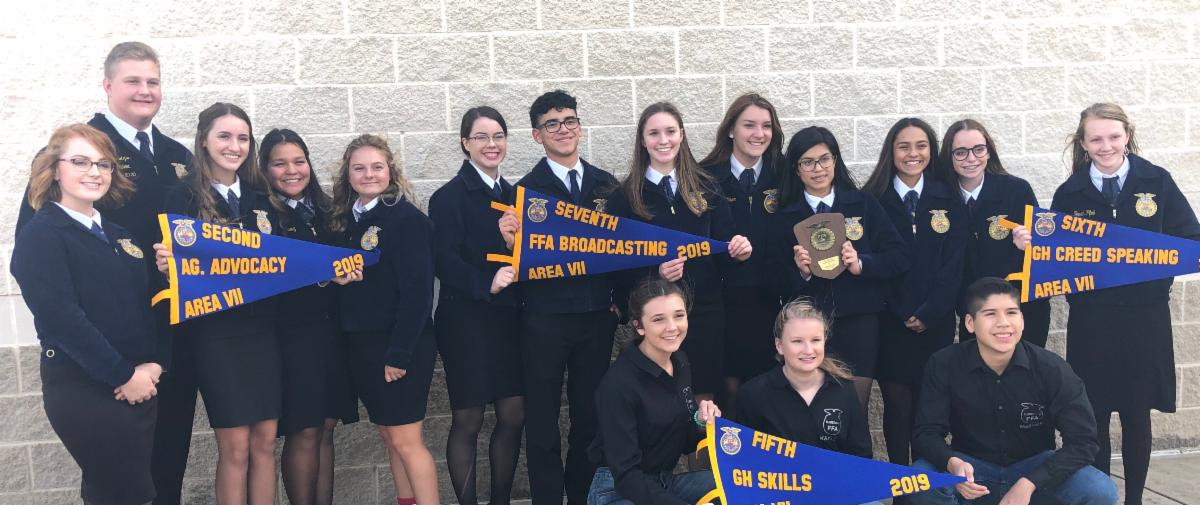 FFA Students Standing with Awards