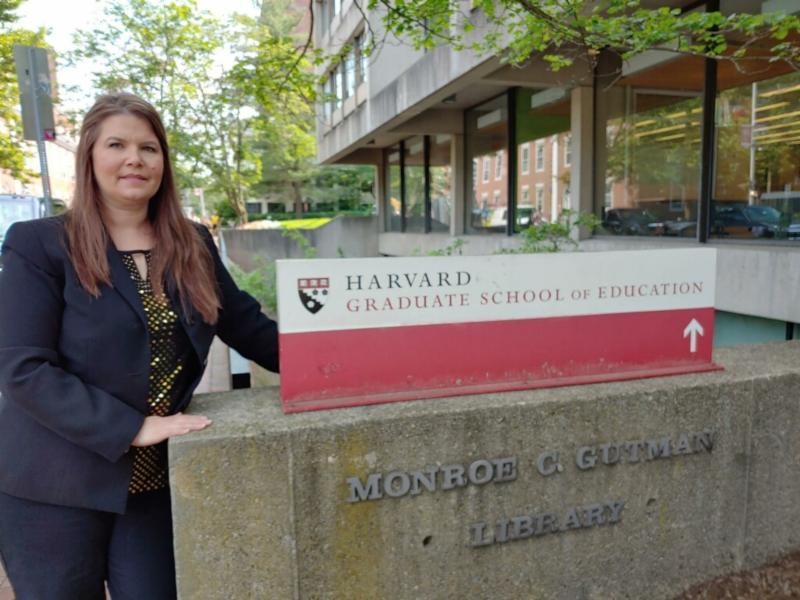 Angela Garcia in front of the Harvard Graduate School of Education Sign.