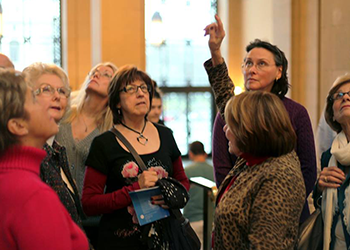 A group of women being taken on a tour of the Detroit Institute of Arts.