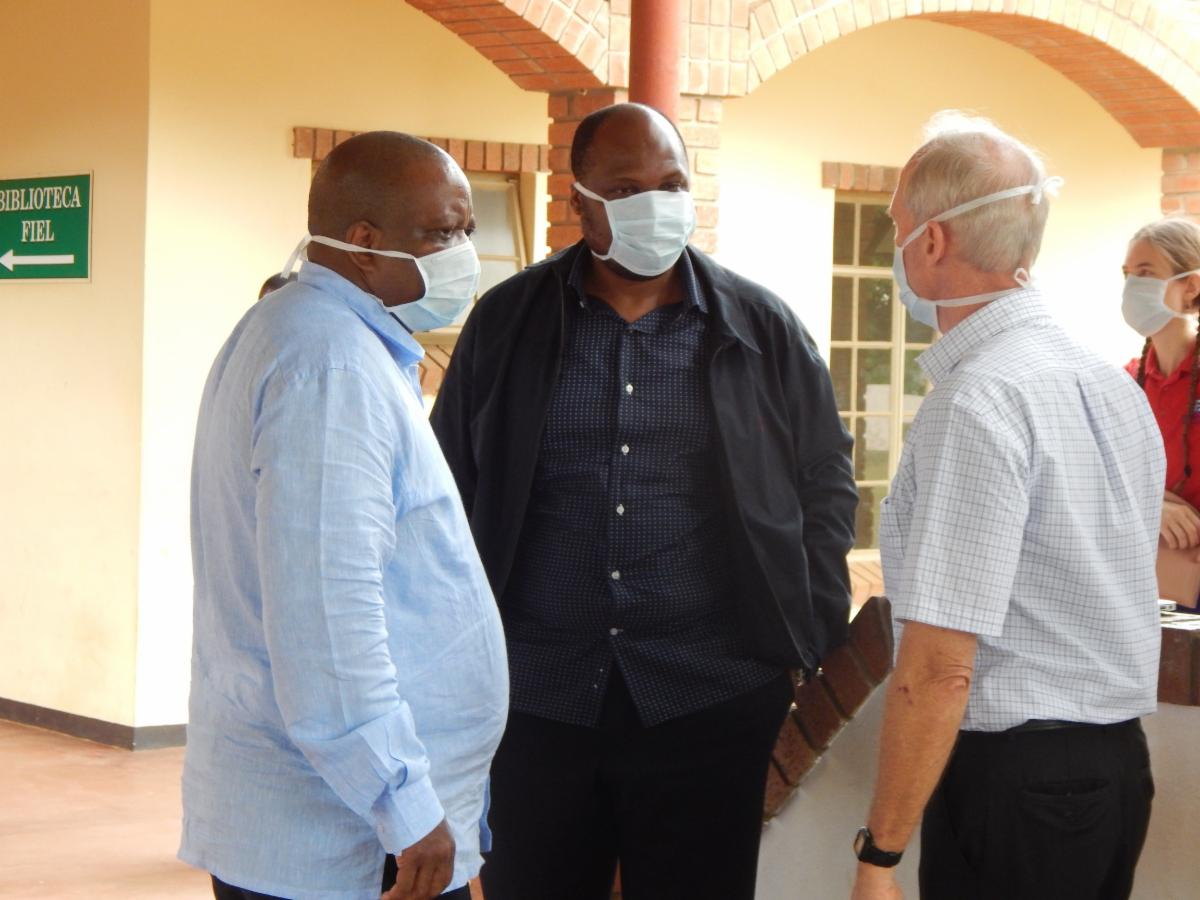 Dr. Charles converses with the governors