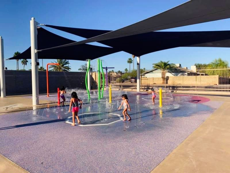 Photo of kids playing in the splash pool at McClintock Pool.