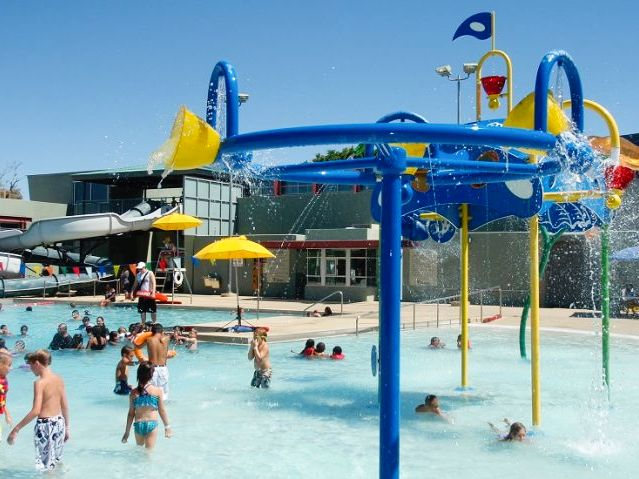 Photo of kids playing on the new splash equipment at Escalante Pool.