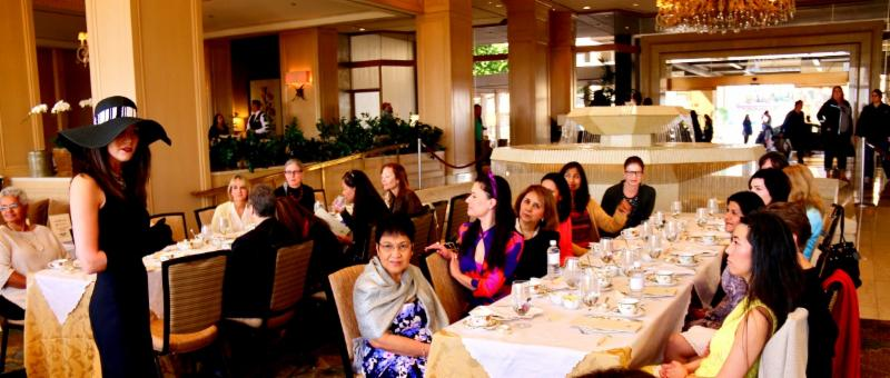 Dr. Amini addresses the attendeees at Afternoon Tea at The Phoenician