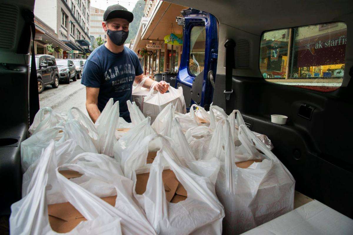 Loading meals for the Juneau CARES program made by the Rookery Cafe