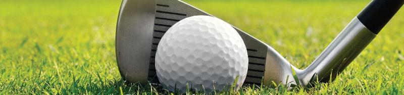 golf tee and ball on green