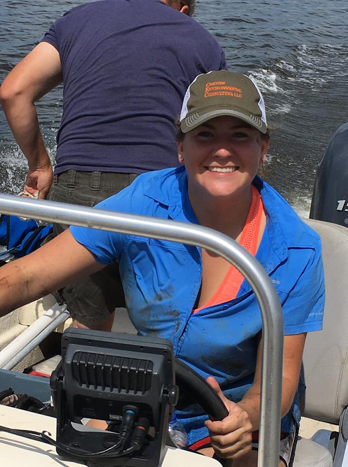 Katie Bowes piloting a boat