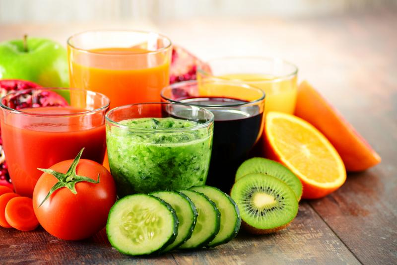 Glasses of fresh organic vegetable and fruit juices. Detox diet.     Note  Shallow depth of field