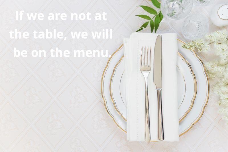 Top view of the beautifully decorated table with white plates crystal glasses linen napkin cutlery and white flower on luxurious tablecloths with space for text
