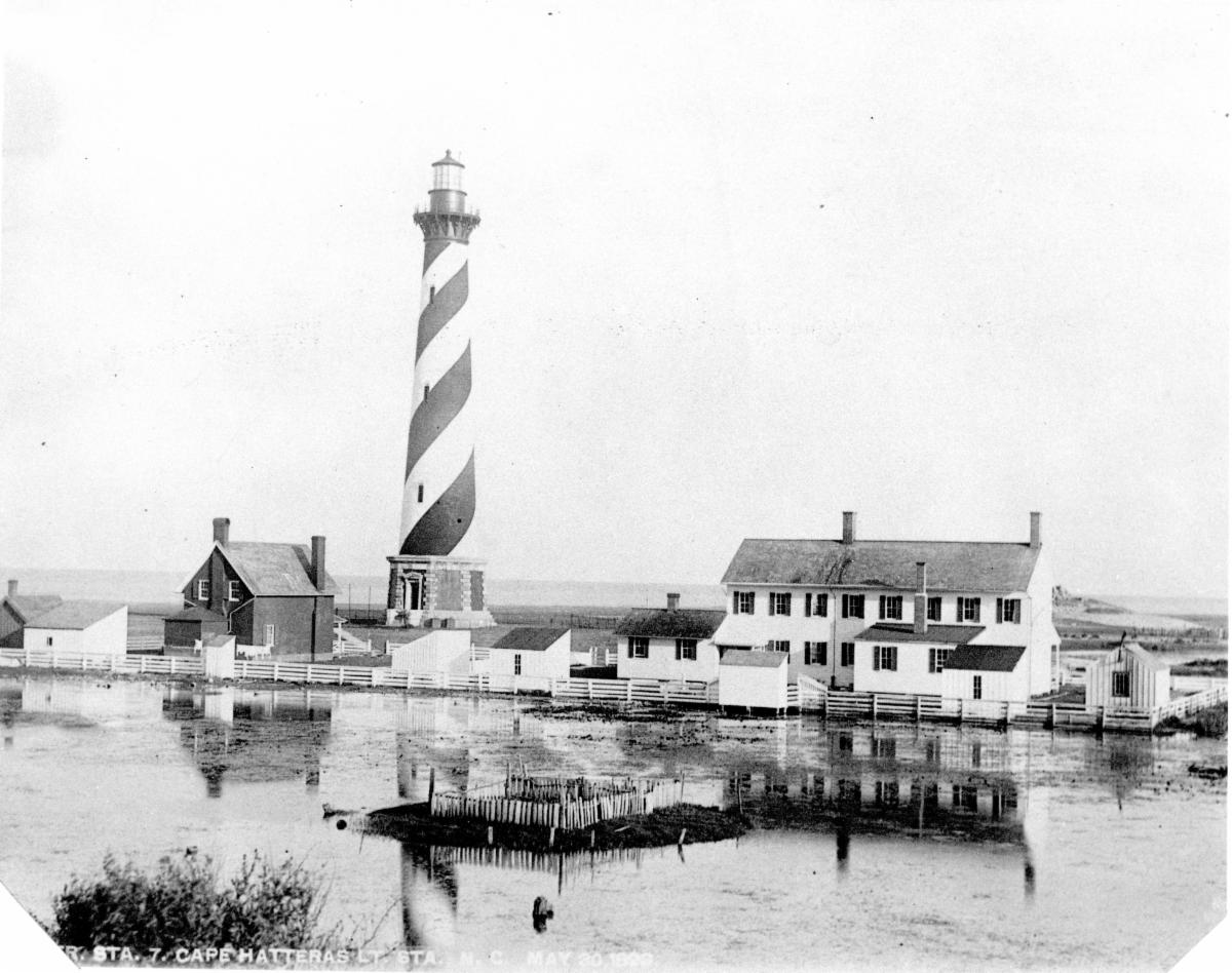 This 1893 photo of Cape Hatteras Light Station was likely taken following a storm event.  The rubble of the original 1802 lighthouse (destroyed in 1871) can be seen to the right of the double keepers' quarters.