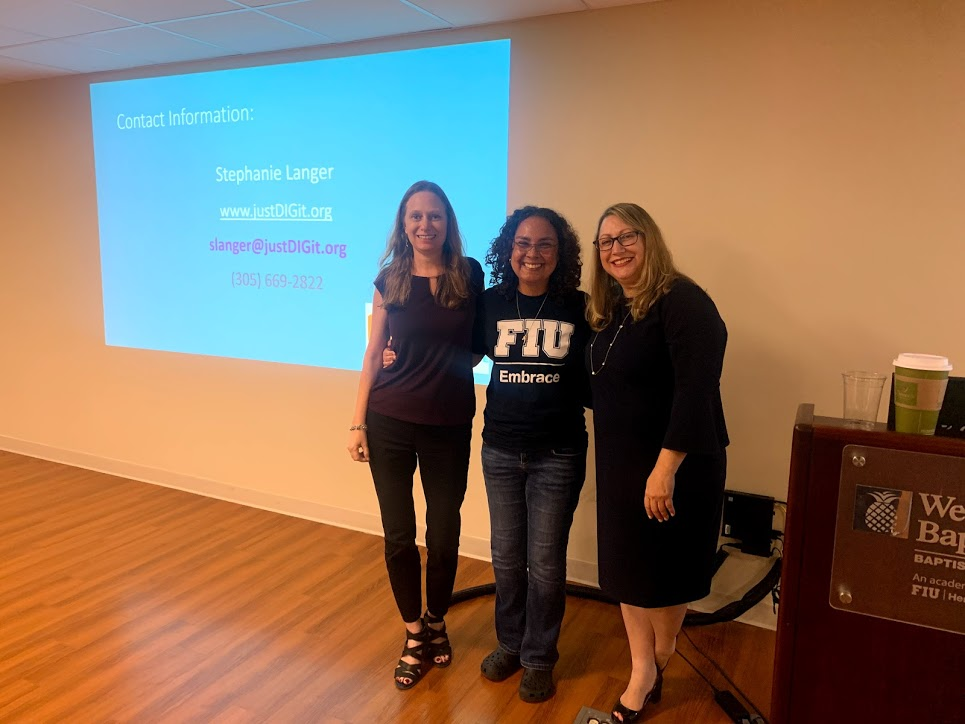 Debbie Nicole and Stephanie standing in front of a screen for a presentation about SSI benefits