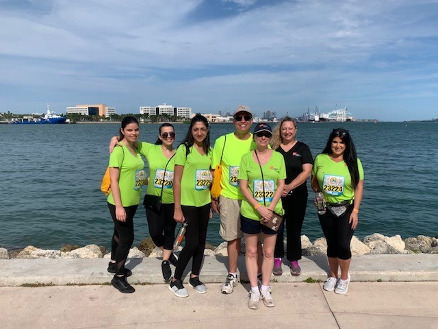 DIG staff at corporate run event standing in front of the water.