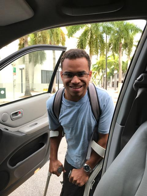 Jansil getting into his car with a big smile on his face.
