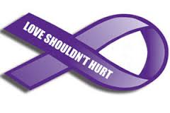 purple ribbon for Domestic Violence month with the words love shouldn't hurt written on it