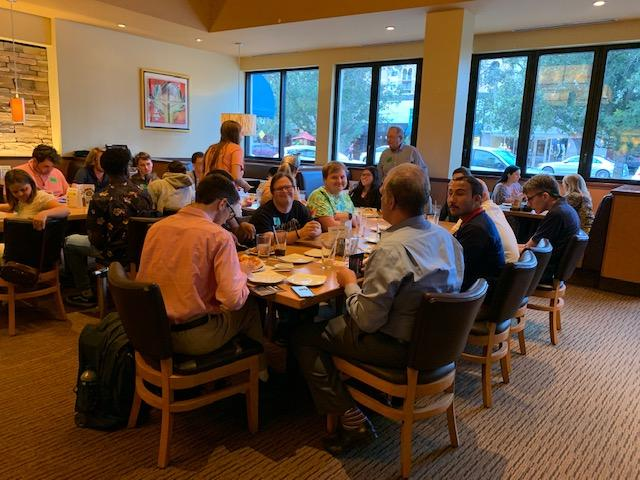 supper social club participants sitting eating dinner at CPK