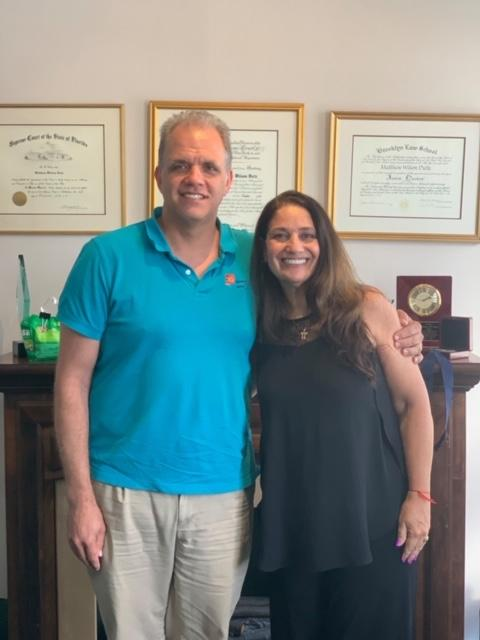 matt and retired judge zabel in his office standing