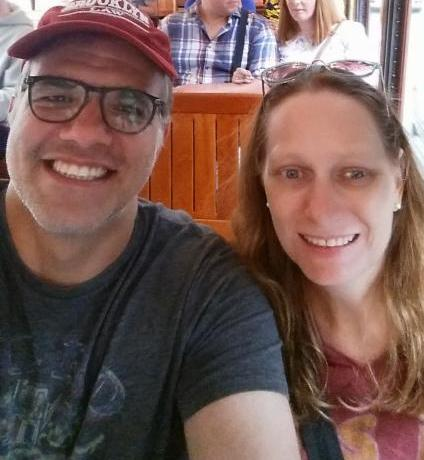 Matt and Debbie sitting on a trolley car in New Orleans.