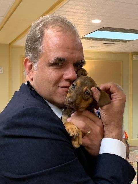 Matt holding a brown puppy