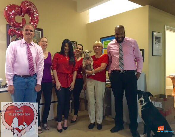 DIG team dressed in red and pink with balloons for valentine's day