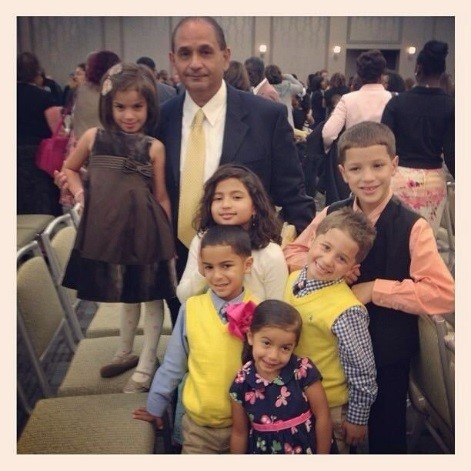 Mr. Rosario and his grandchildren.