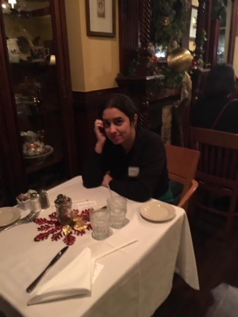 Luisa sitting at the Supper Social Dinner at John Martin's Restaurant