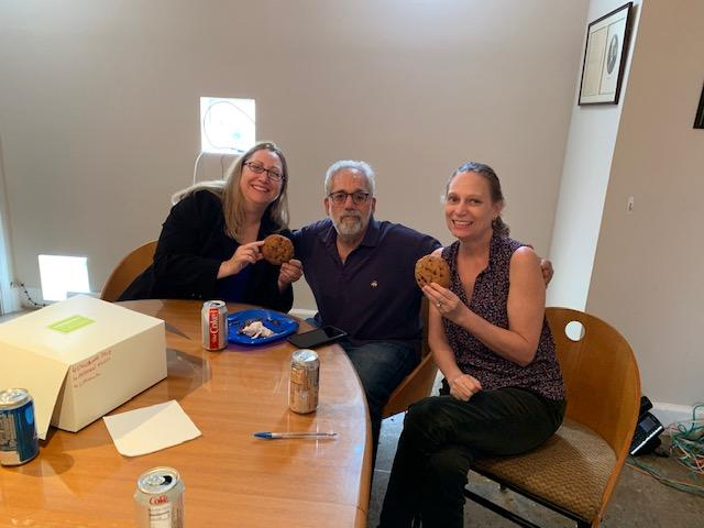 Stephanie Larry and Debbie holding chocolate chip cookies after our lunch and learn event