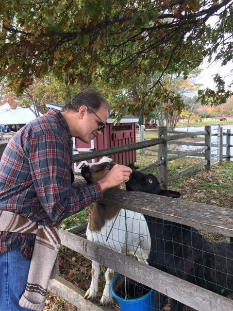 Matt petting 2 goats at a farm in Massachusetts.