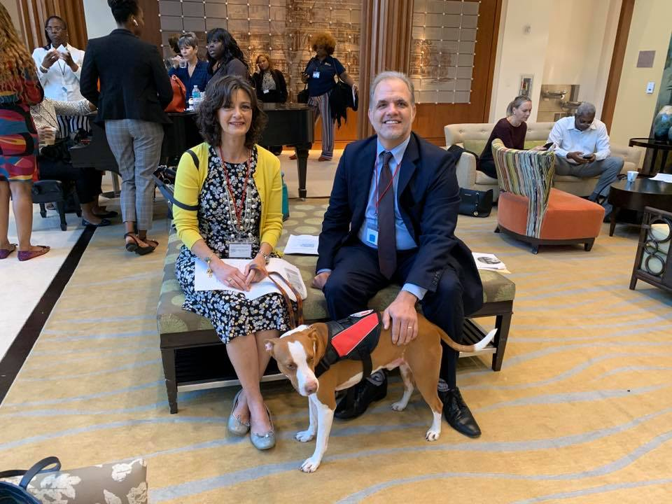 Judge Figarola Rogelio the dog and Matt sitting in the lobby at the CBC Alliance Conference