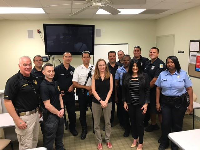 Debbie and Lisa standing with police officers.
