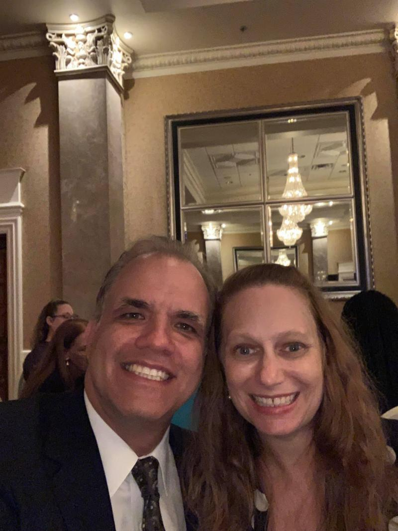 a selfie of matt and debbie at the retirement dinner for justice lewis