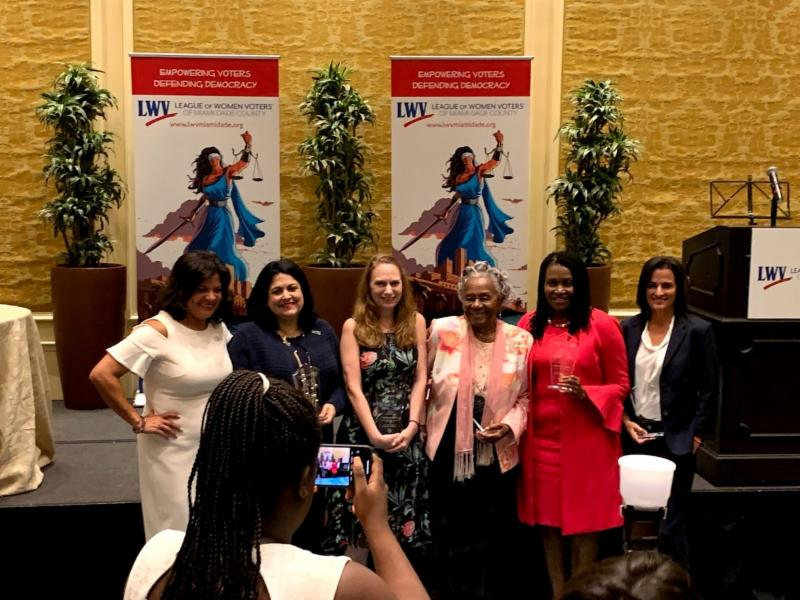 winners at the LWV women who shine event standing by the stage