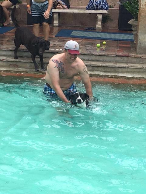 Matt teaching Lucy how to swim