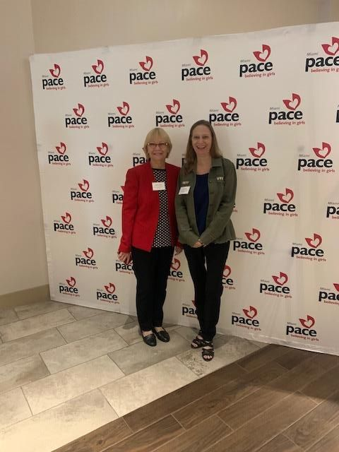 sharon and debbie standing at the pace center luncheon