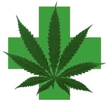 a green cross with a marijuana leaf in the middle of it.