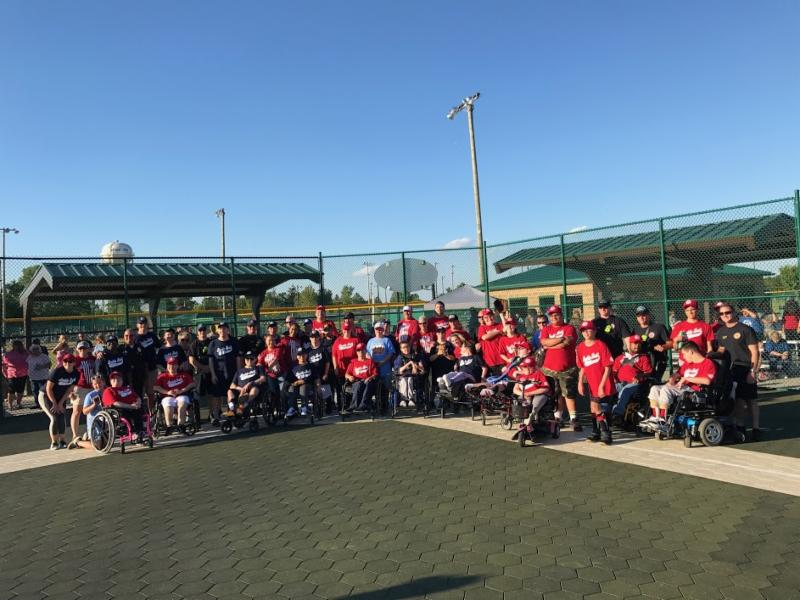 buddy ball league players and first responders on the baseball field.