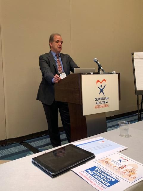 Matt standing at a lectern presenting at the GAL conference