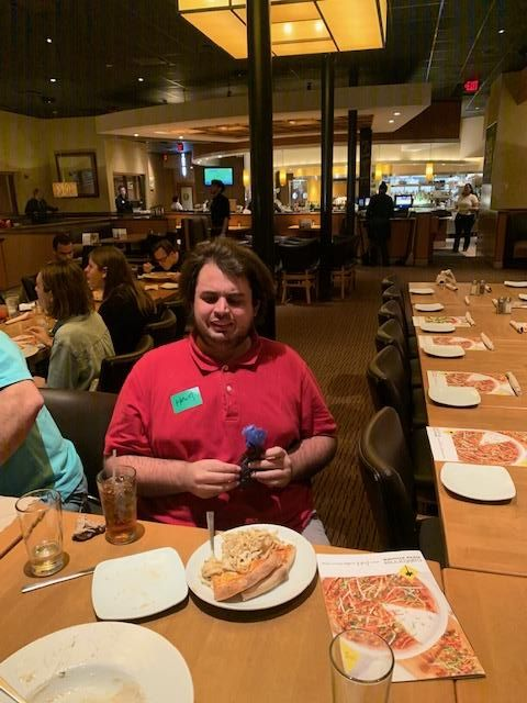 January Supper Social Raffle Winner Heath holding his prize