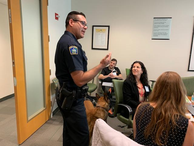 Officer Alex and Roy the dog being introduced to the team