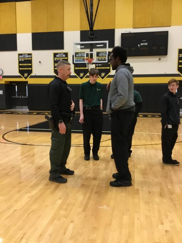 students role playing with police officers